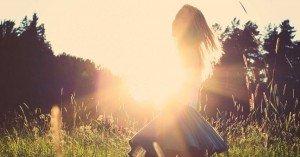 girl in sun in a field