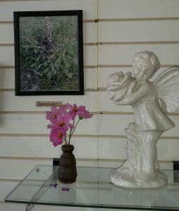 child angel statue with pink flowers